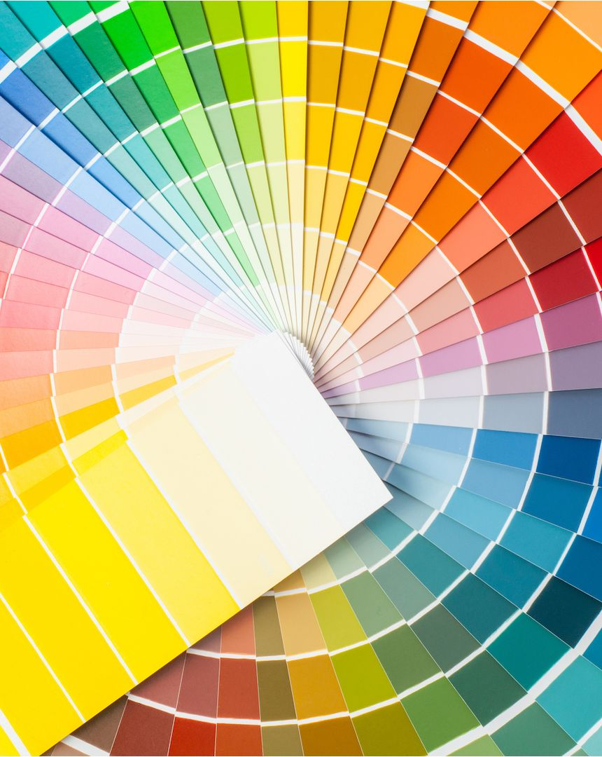 A large number of rainbow coloured paint colour swatches are fanned out in a circle.