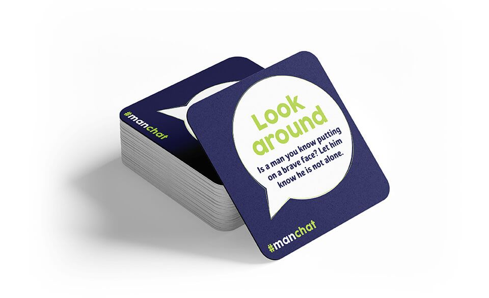A stack of printed coasters offering advice on how to spot a depressed friend in need.