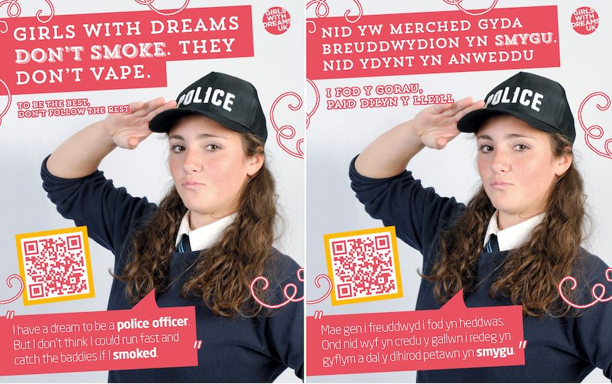 English and Welsh DreamBig campaign posters showing a teenage girl saluting in a police uniform.