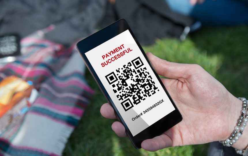 A QR code is shown on a smartphone.