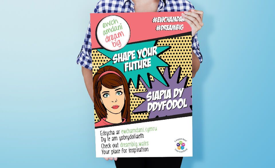 Someone holds an illustrated, pop-art style bilingual campaign poster.