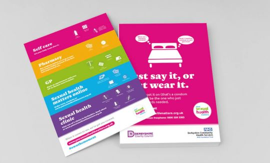 A stack of colourful flyers promoting safe sex from the Your Sexual Health Matters campaign.