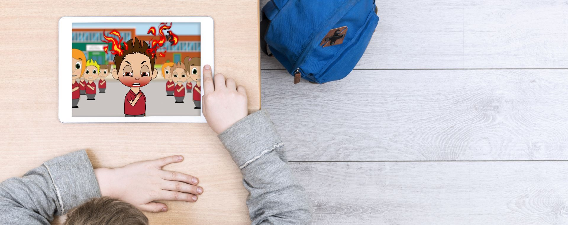A young boy watches an Ipad on a table, showing the Just Talk mental health animation.