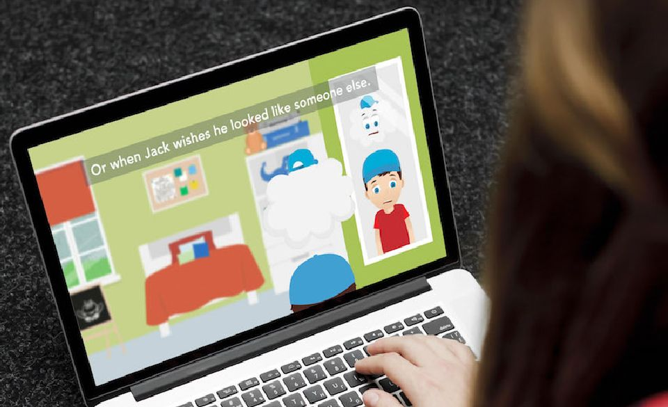 A person on a laptop, watching the Just Talk animation on the screen.