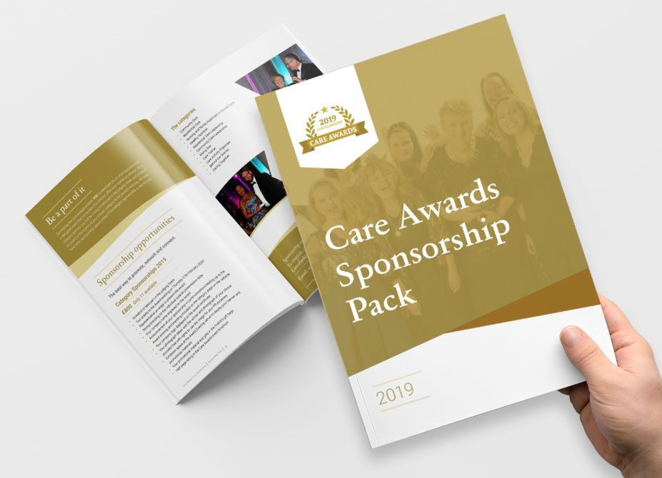 A hand holding a Lincolnshire Care Awards programme above a second open programme.