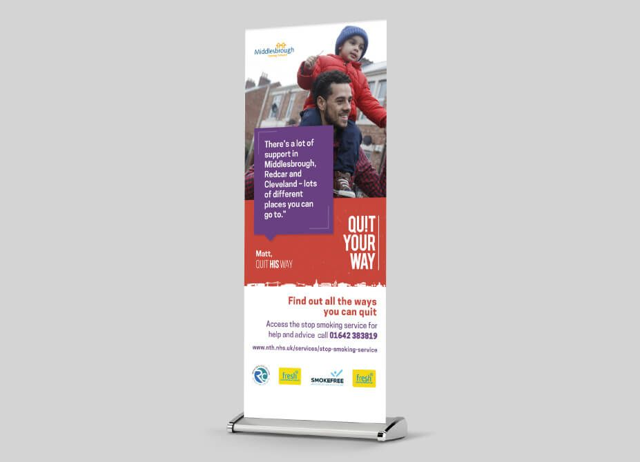 A pop-up banner featuring a man carrying his son and a quote regarding stop smoking services.