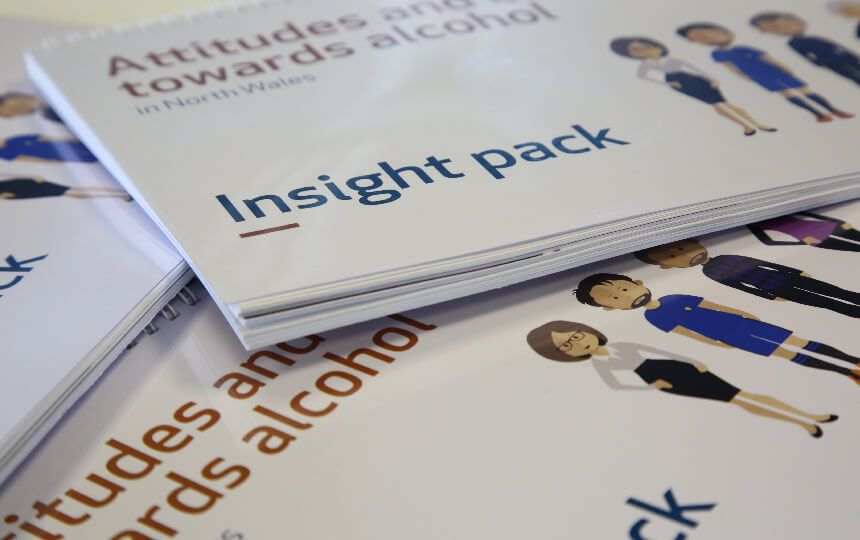 Three 'who drinks alcohol and why' insight reports piled on a surface.